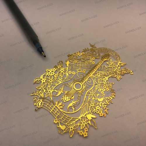 laser cutting on brass guitar art cutting
