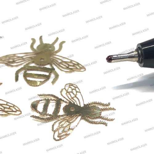 laser cutting on brass honey bee pendant